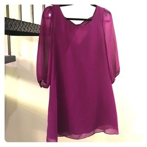 Sheer sleeved purple dress with bow detail on back